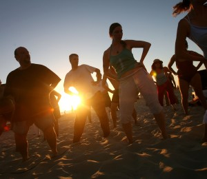 TEL AVIV, ISRAEL - JULY 11: (ISRAEL OUT) Israelis dance at the beach at the end of a hot summer's day July 11, 2007 in Tel Aviv. (Photo by Uriel Sinai/Getty Images)
